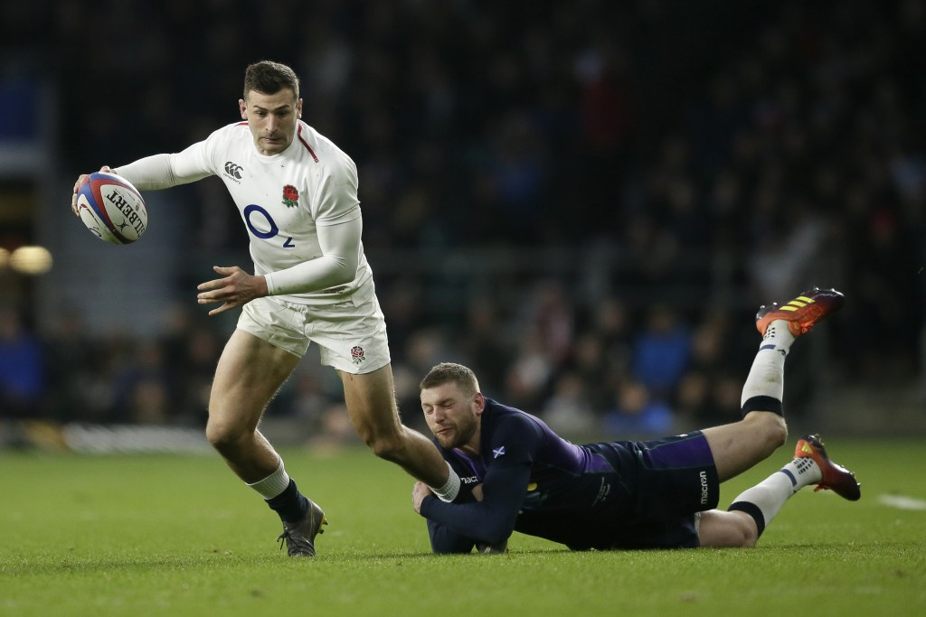 England's Jonny May is tackled by Scotland's Finn Russell during the Six Nations rugby union international between England and Scotland at Twickenham