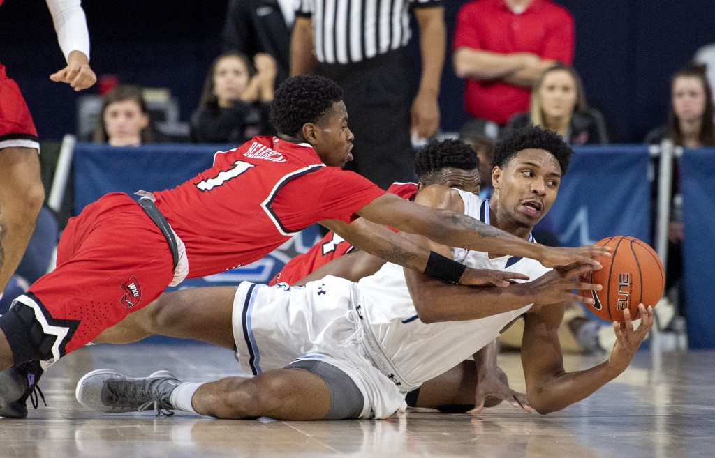 Old Dominion guard Jason Wade, right, competes for a loose ball with Western Kentucky guard Lamonte Bearden (1) during the first half of an NCAA colle