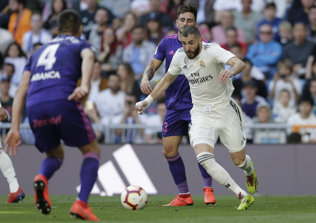 Real Madrid's Karim Benzem, right, controls the ball during a Spanish La Liga soccer match between Real Madrid and Celta at the Santiago Bernabeu stad
