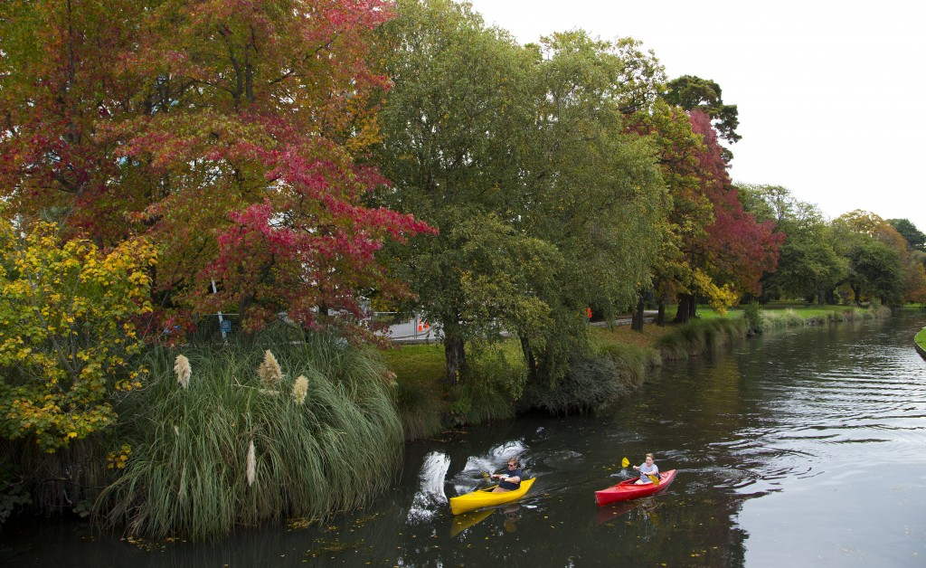 FILE - In this April 19, 2017, file photo, kayakers paddle down the Avon River in Christchurch, New Zealand. Despite its tranquility and beauty, New Z