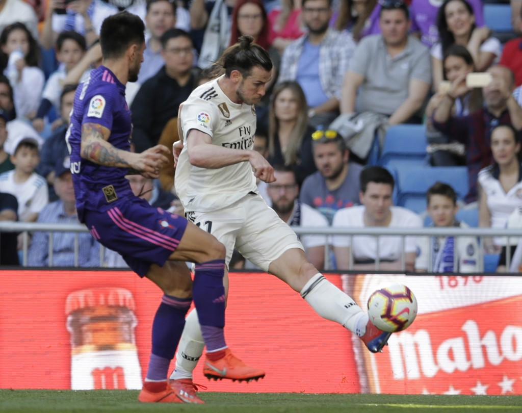 Real Madrid's Gareth Bale kicks the ball during a Spanish La Liga soccer match between Real Madrid and Celta at the Santiago Bernabeu stadium in Madri