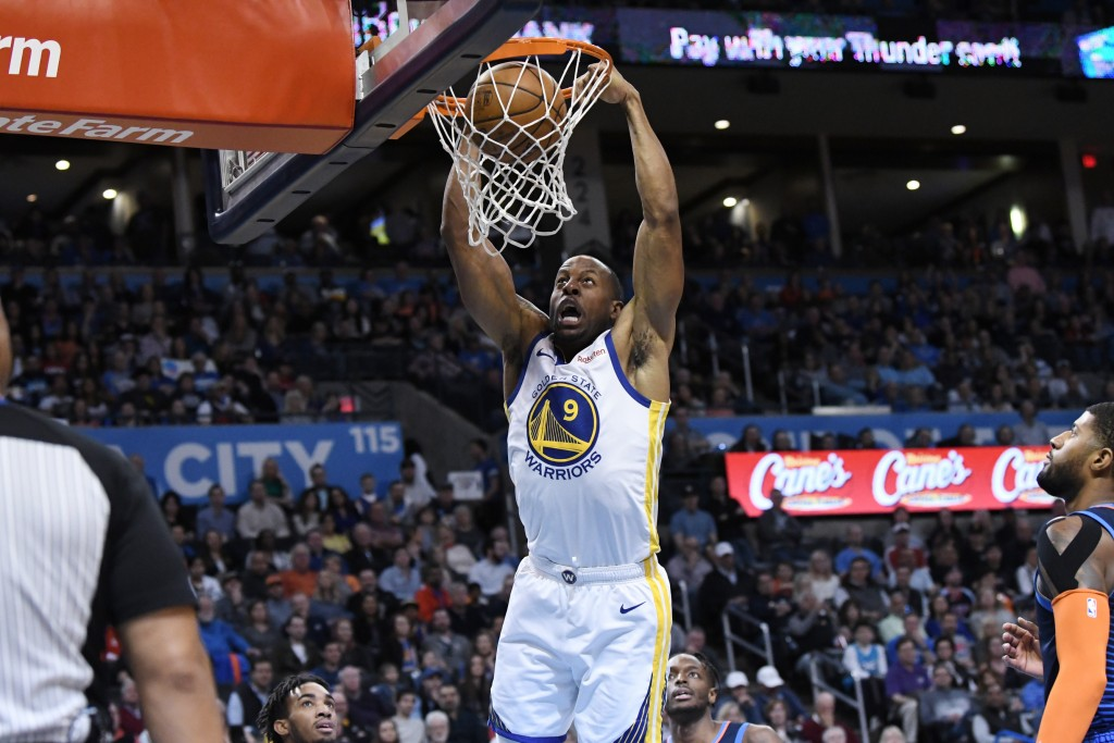 Golden State Warriors guard Andre Iguodala scores against Oklahoma City Thunder during the first of an NBA basketball game Saturday, March 16, 2019 in