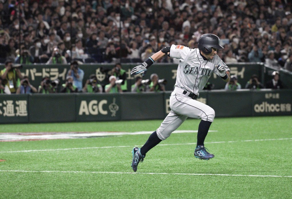 Seattle Mariners' Ichiro Suzuki heads to first as he grounds out in the fourth inning of a pre-season exhibition baseball game against the Yomiuri Gia