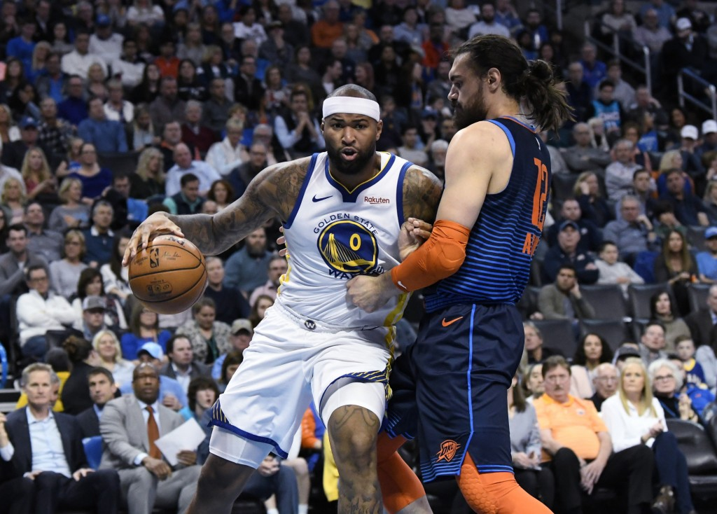 Oklahoma City Thunder center Steven Adams (12) defends against Golden State Warriors center DeMarcus Cousins (0) during the first half of an NBA baske