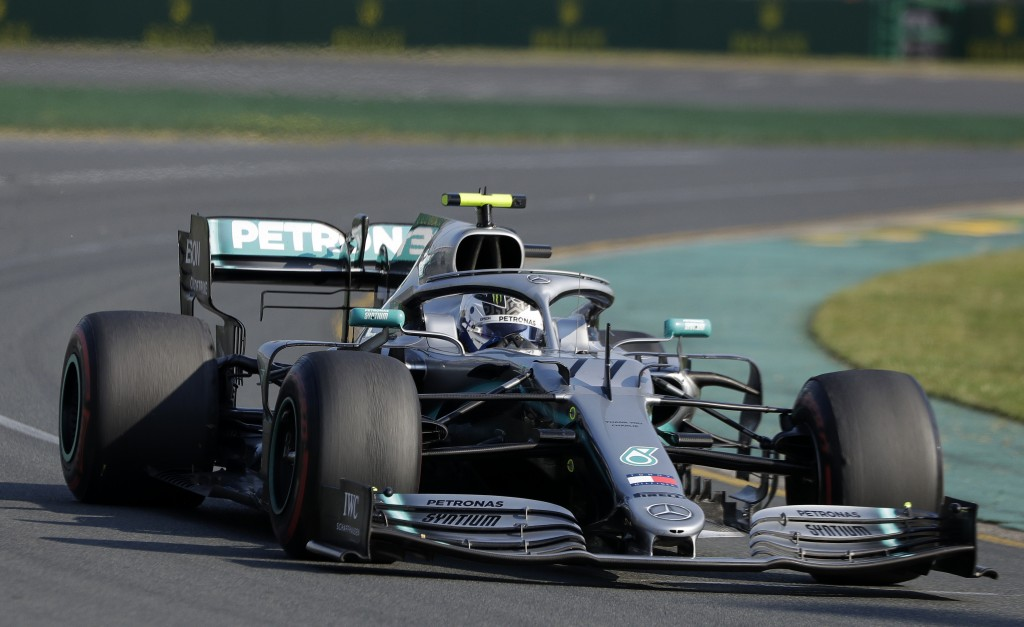 Mercedes driver Valtteri Bottas of Finland goes through turn 2 as he leads during the Australian Formula 1 Grand Prix in Melbourne, Australia, Sunday,