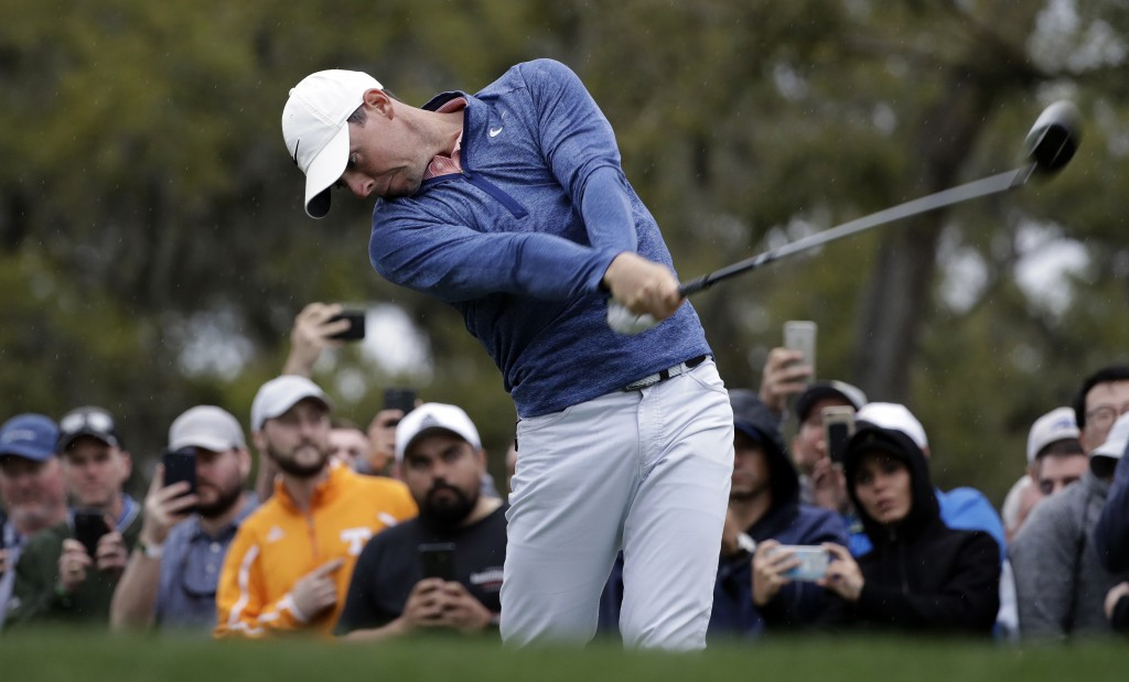 Rory McIlroy, of Northern Ireland, tees off on the 12th hole during the third round of The Players Championship golf tournament Saturday, March 16, 20