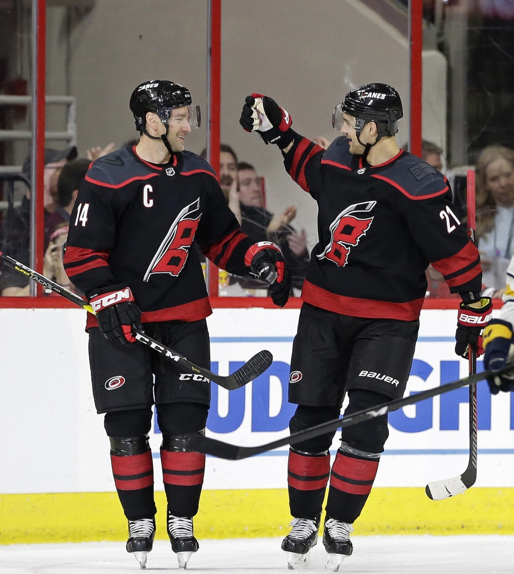 Carolina Hurricanes' Justin Williams (14) is congratulated by Nino Niederreiter (21), of the Czech Republic, following Williams' goal against the Buff