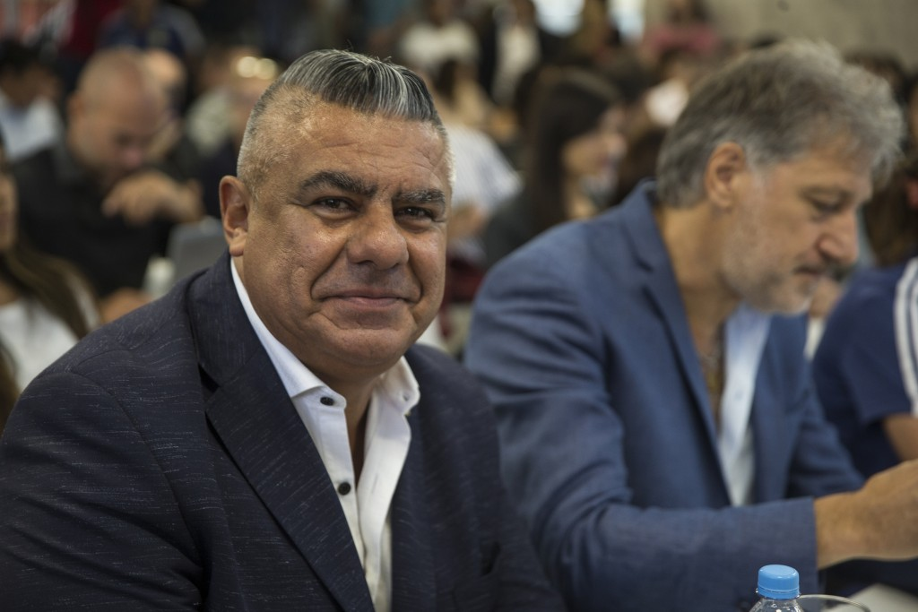 Claudio Tapia, president of Argentina's Soccer Federation, smiles as he poses for pictures during a press conference to announce the early implementat...