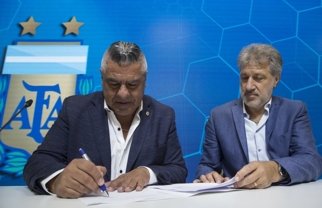 General Secretary of the Argentina's Footballers' Union (FAA) Sergio Marchi, right, Claudio Tapia, president of Argentina's Soccer Federation, left, s
