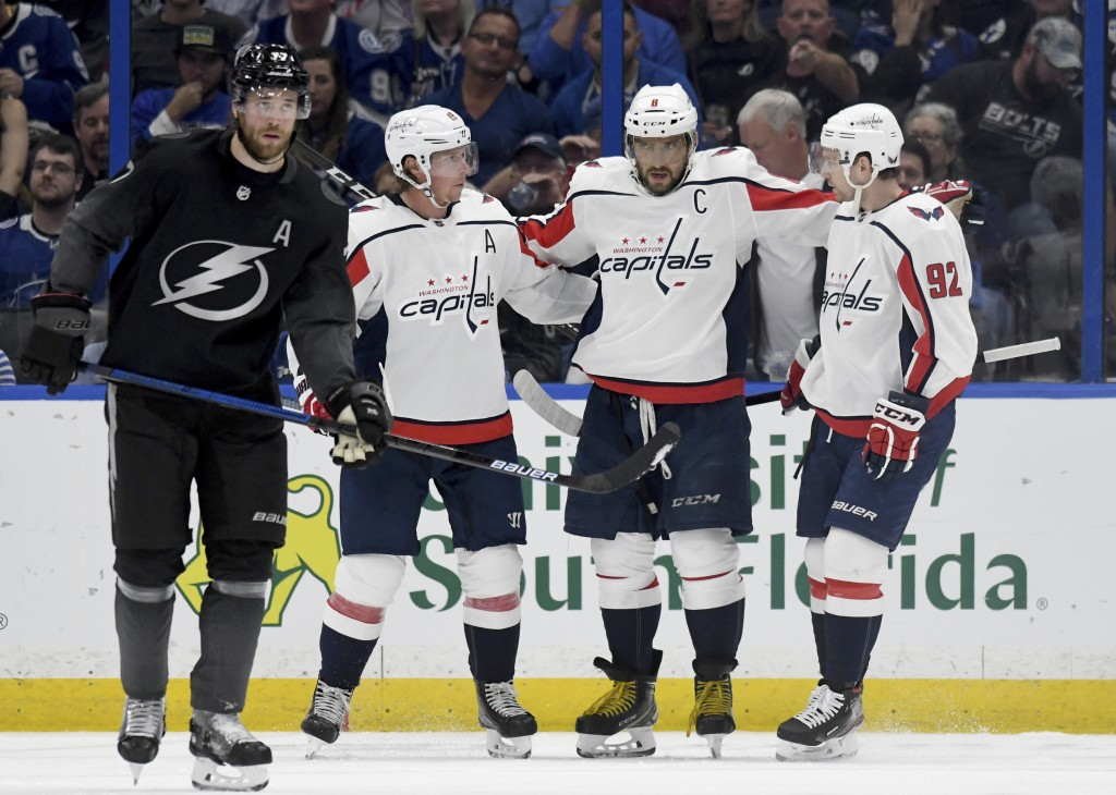 Tampa Bay Lightning defenseman Victor Hedman (77) skates away as Washington Capitals Nicklas Backstrom (19), Alex Ovechkin (8) and Evgeny Kuznetsov (9