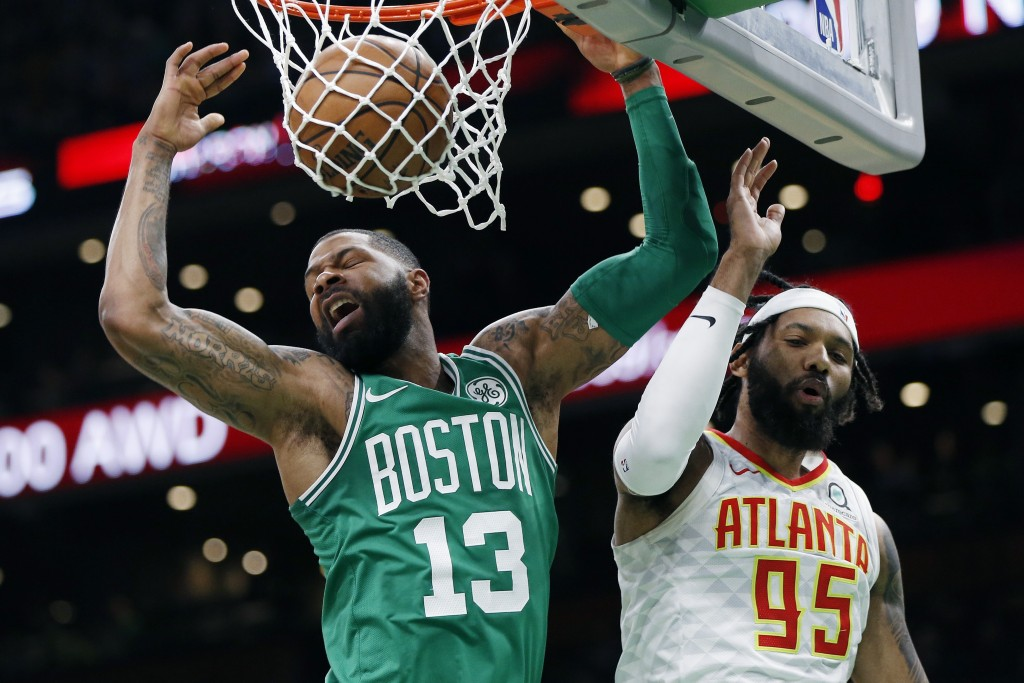Boston Celtics' Marcus Morris (13) dunks against Atlanta Hawks' DeAndre' Bembry (95) during the first half of an NBA basketball game in Boston, Saturd