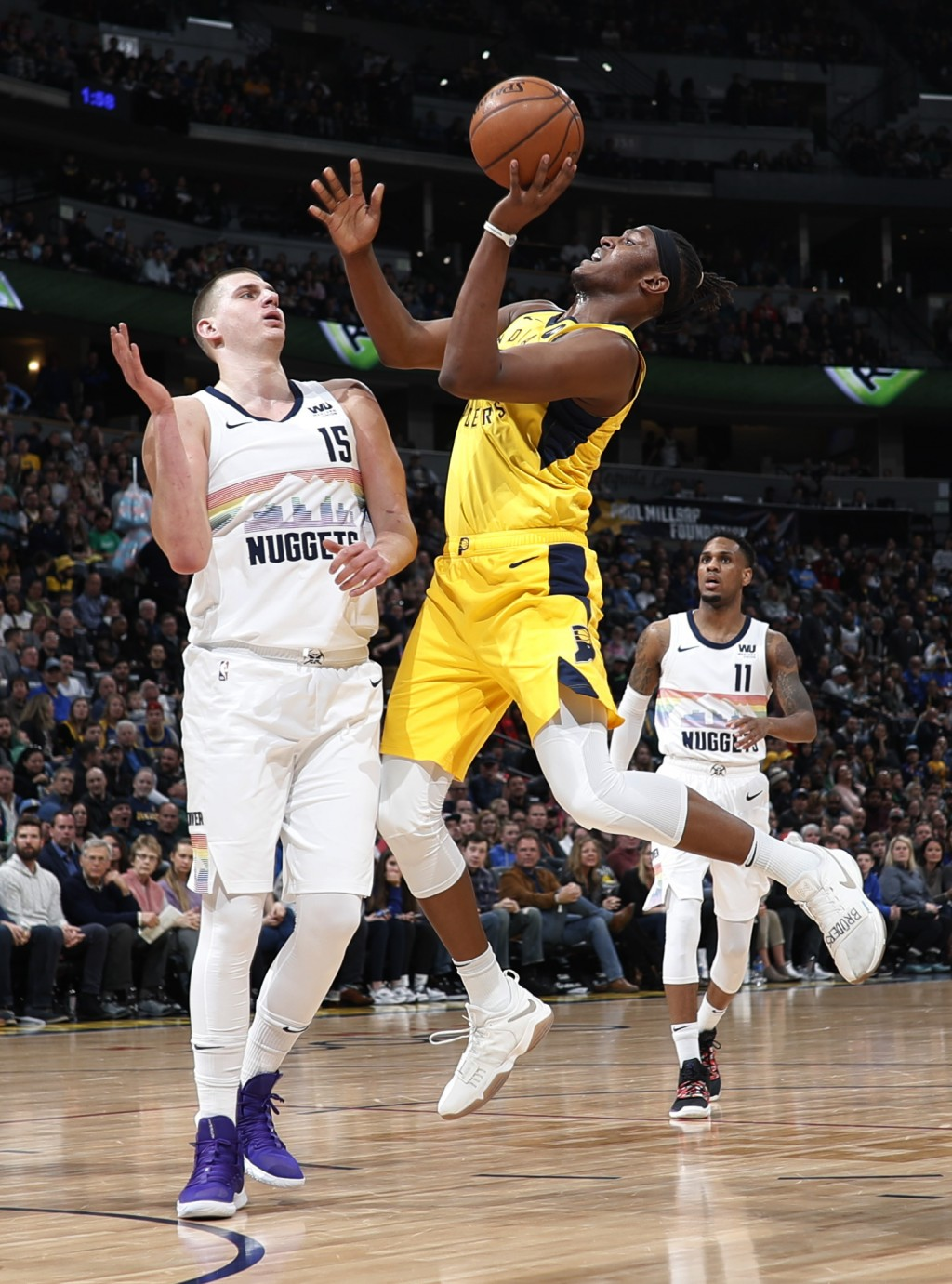 Indiana Pacers center Myles Turner, right, got up for a basket as Denver Nuggets center Nikola Jokic defends during the first half of an NBA basketbal