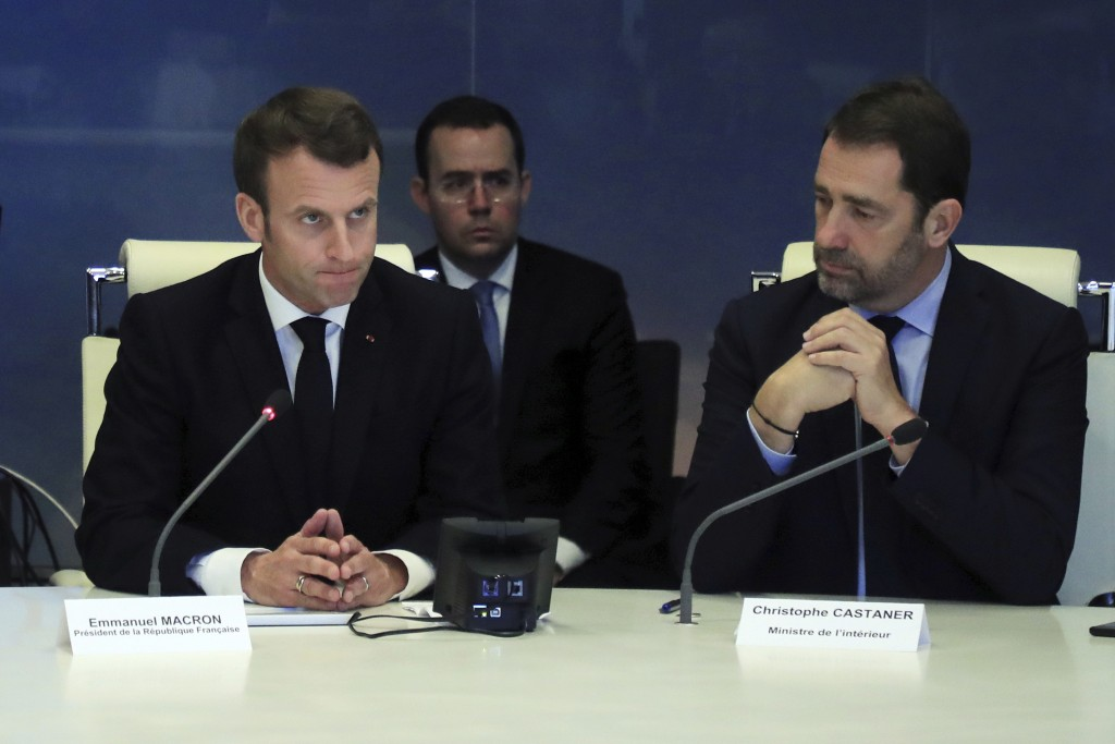 French President Emmanuel Macron, left, presides over an emergency crisis meeting with French Interior Minister Christophe Castaner, at the Interior M