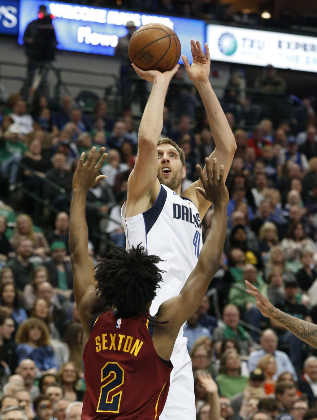 Dallas Mavericks forward Dirk Nowitzki (41) shoots over Cleveland Cavaliers guard Collin Sexton (2) during the first half of an NBA basketball game in