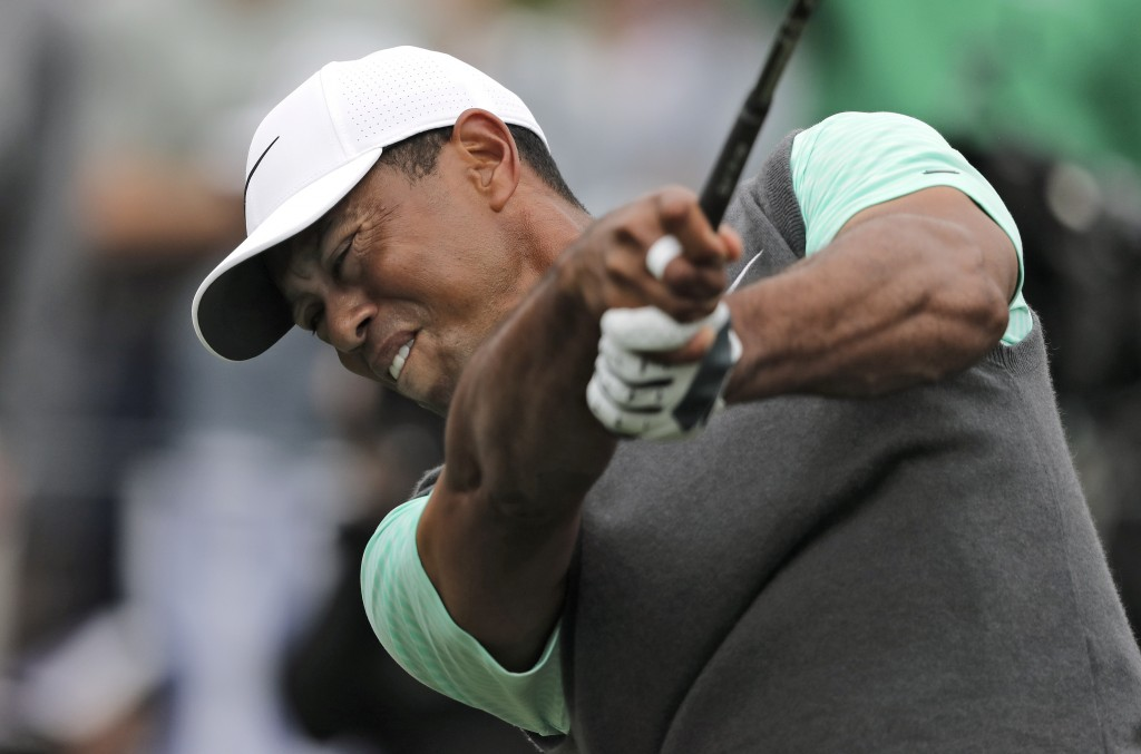 Tiger Woods tees off on the fourth hole during the third round of The Players Championship golf tournament Saturday, March 16, 2019, in Ponte Vedra Be...