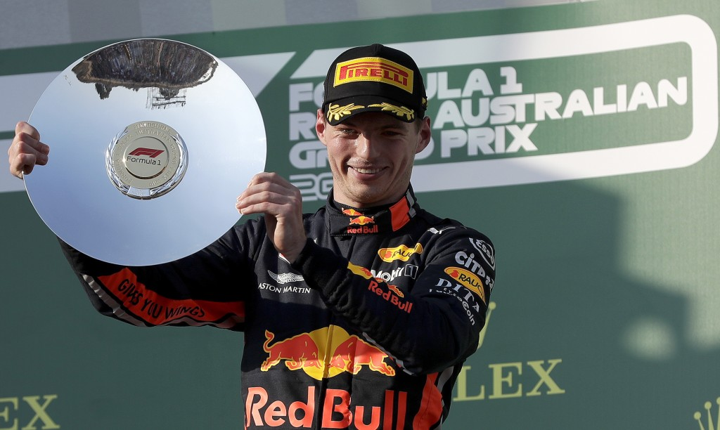 Red Bull driver Max Verstappen of the Netherlands holds up his trophy after coming third in the Australian Formula 1 Grand Prix in Melbourne, Australi