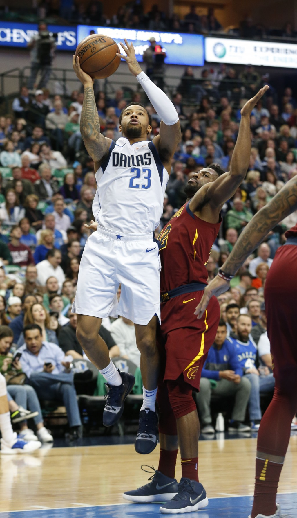 Dallas Mavericks guard Trey Burke (23) shoots in front of Cleveland Cavaliers guard David Nwaba during the first half of an NBA basketball game in Dal