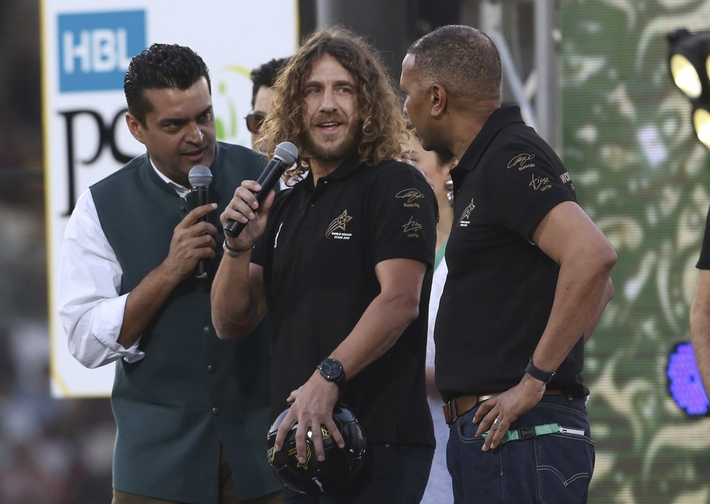 Retired Barcelona soccer player Carles Puyol, center, attends the closing ceremony of the Pakistan Super League, prior to the final cricket match at N