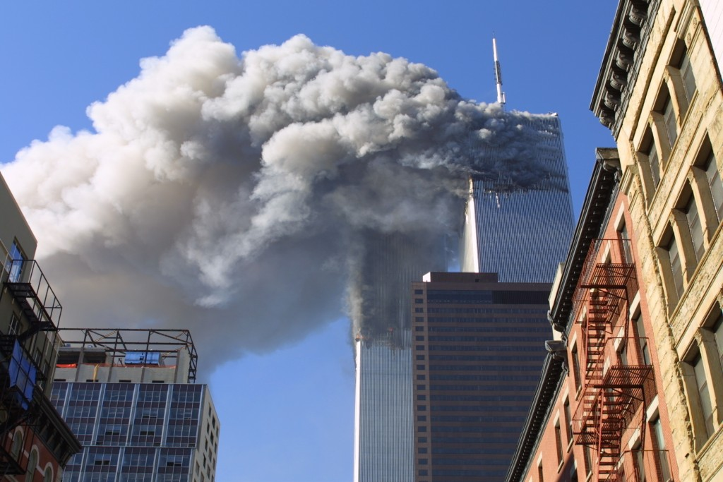 FILE - In this Sept. 11, 2001 file photo, the twin towers of the World Trade Center burn after hijacked planes crashed into them in New York as part o