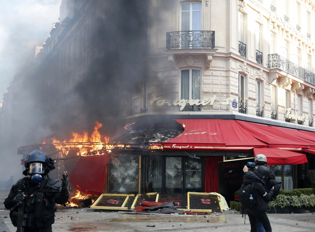 Paris famed restaurant Fouquet's burns on the Champs Elysees avenue during a yellow vests demonstration Saturday, March 16, 2019 in Paris. Paris polic