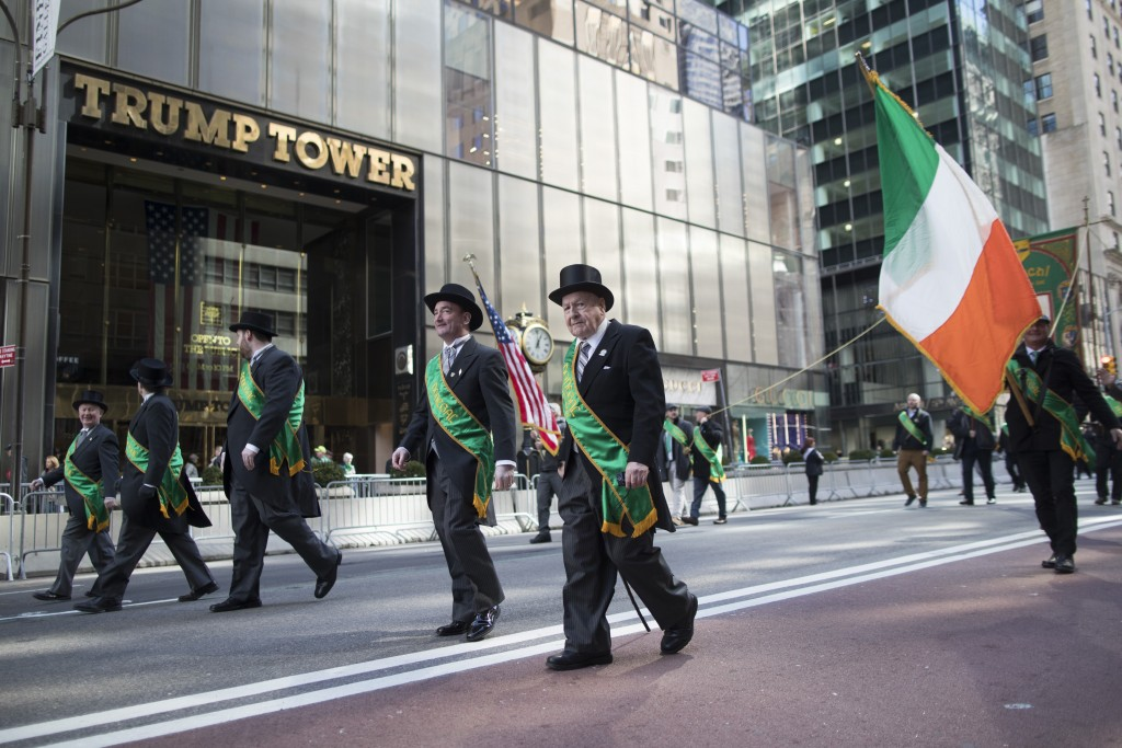 Participants march up Fifth Avenue past Trump tower during the St. Patrick's Day Parade, Saturday, March 16, 2019, in New York. (AP Photo/Mary Altaffe