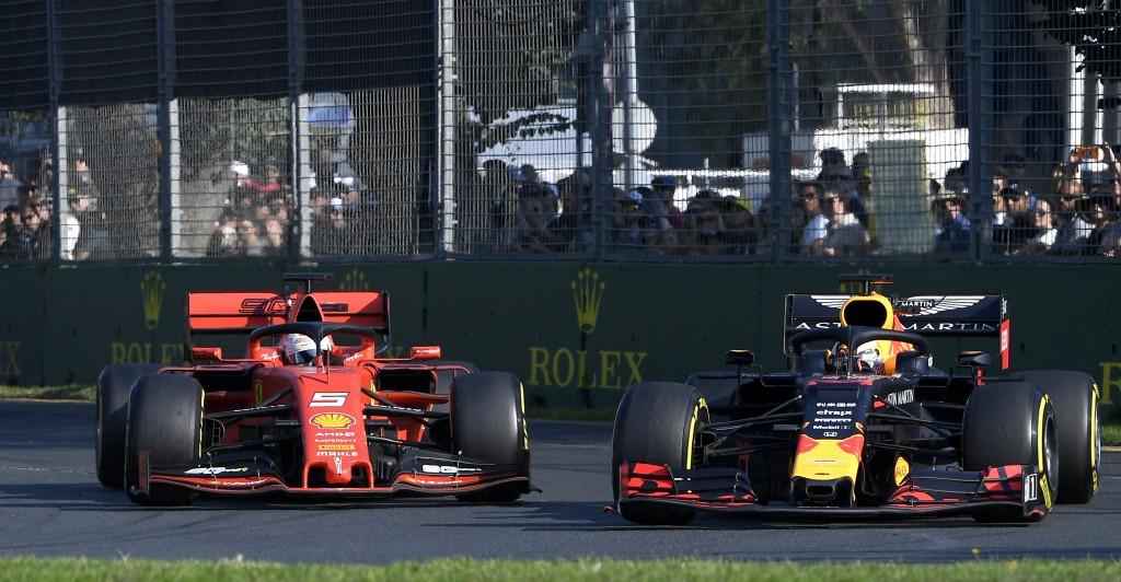 Red Bull driver Max Verstappen of the Netherlands, right, passes Ferrari driver Sebastian Vettel of Germany during the Australian Formula 1 Grand Prix