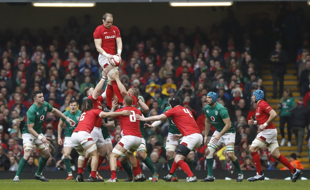 Wales captain Alun Wyn Jones, passes down the ball in a line out during the Six Nations international rugby union match between Wales and Ireland at t