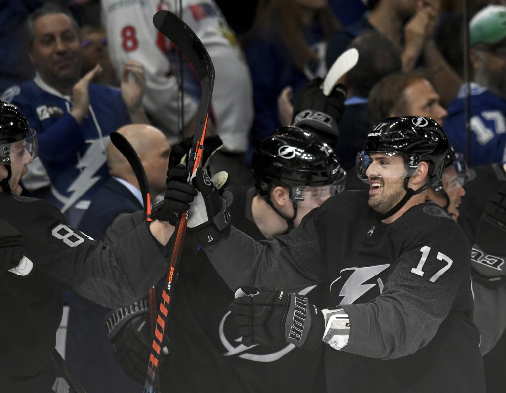 Tampa Bay Lightning left wing Alex Killorn (17) celebrates his third goal of the night during the third period of an NHL hockey game against the Washi