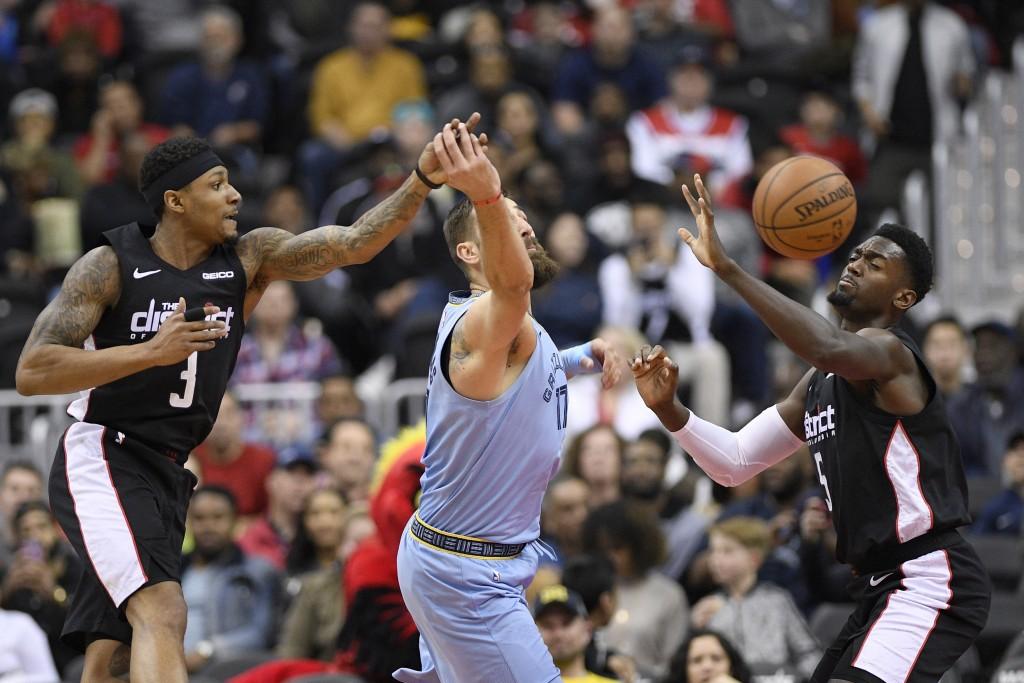 Washington Wizards guard Bradley Beal (3) and forward Bobby Portis (5) battles for the ball against Memphis Grizzlies center Jonas Valanciunas, center