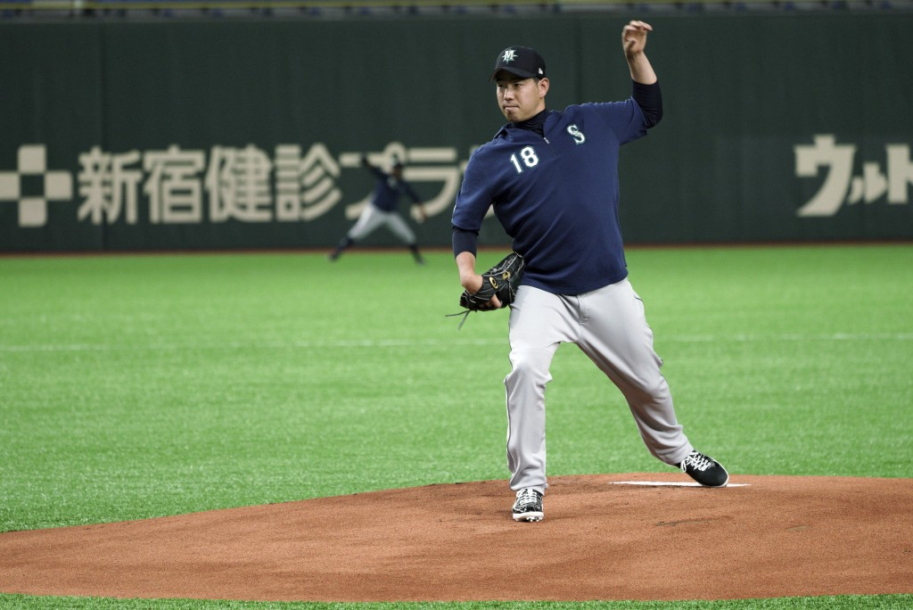 Seattle Mariners pitcher Yusei Kikuchi swings his left arm on the mound during his team's practice at Tokyo Dome in Tokyo, Saturday, March 16, 2019. J