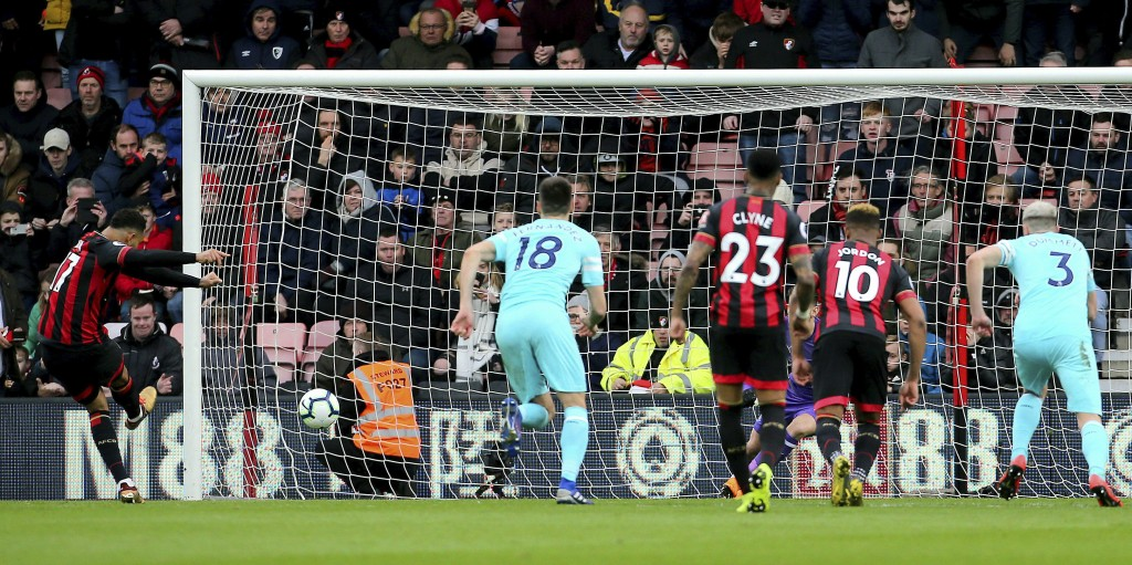 AFC Bournemouth's Joshua King, left, scores his side's first goal of the game from the penalty spot during their English Premier League soccer match a