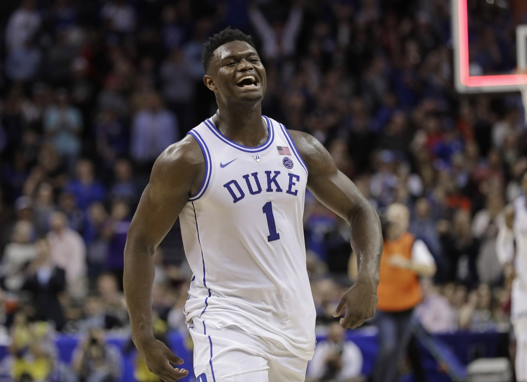 Duke's Zion Williamson (1) celebrates after Duke defeated Florida State in the NCAA college basketball championship game of the Atlantic Coast Confere