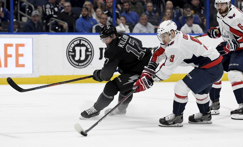 Washington Capitals defenseman Dmitry Orlov (9) steals the puck from Tampa Bay Lightning left wing Alex Killorn (17) during the second period of an NH