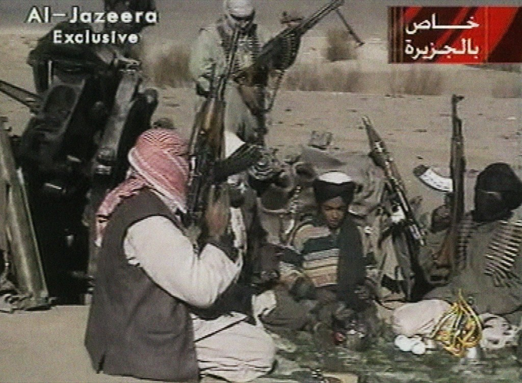 FILE - In this Nov. 5, 2001 image made from video broadcast by the Qatari-based  television station Al-Jazeera, a young boy, center, identified as Ham