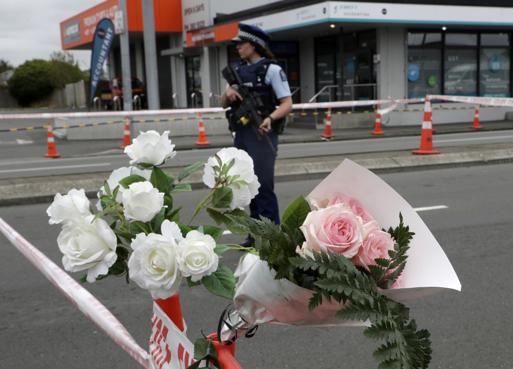 A police officer stands at a police cordon at an intersection near the Linwood Mosque in Christchurch, New Zealand, Sunday, March 17, 2019. The live-s