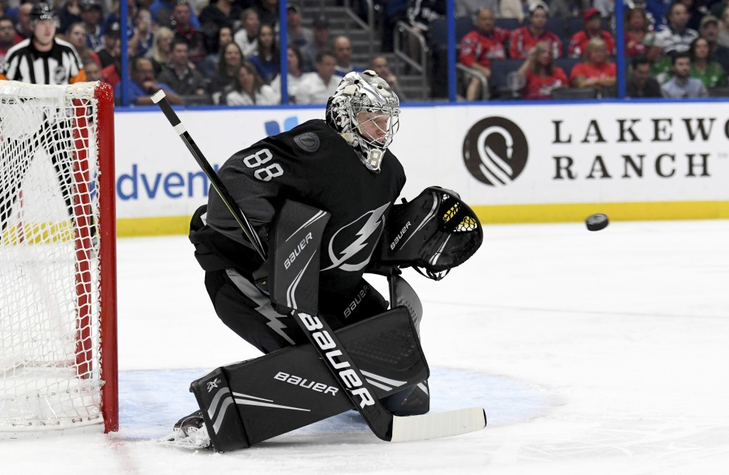 Tampa Bay Lightning goaltender Andrei Vasilevskiy (88) makes a save during the first period of an NHL hockey game against the Washington Capitals Satu