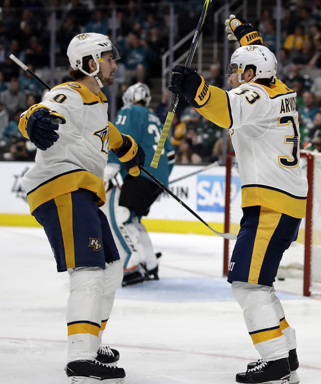 Nashville Predators' Viktor Arvidsson, right, celebrates with Filip Forsberg after scoring a goal against the San Jose Sharks during the second period