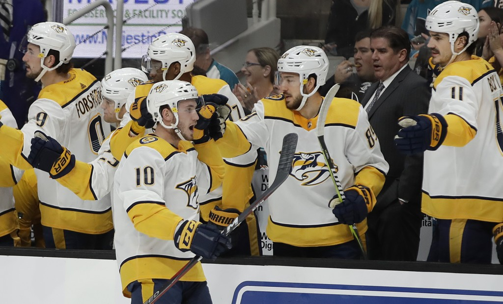 Nashville Predators' Colton Sissons (10) is congratulated after scoring a goal against the San Jose Sharks during the first period of an NHL hockey ga