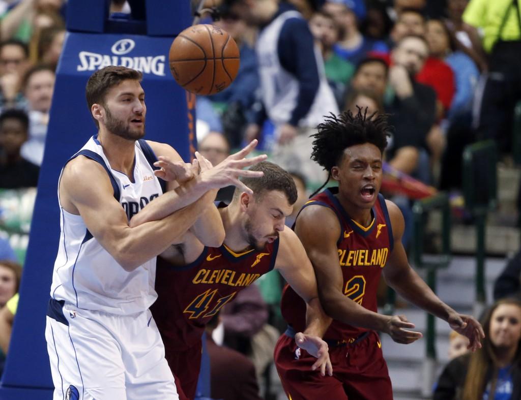 Dallas Mavericks forward Maximilian Kleber (42) competes for the ball with Cleveland Cavaliers center Ante Zizic (41) and guard Collin Sexton (2) duri