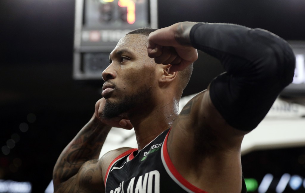 Portland Trail Blazers guard Damian Lillard celebrates a score against the San Antonio Spurs during the second half of an NBA basketball game in San A