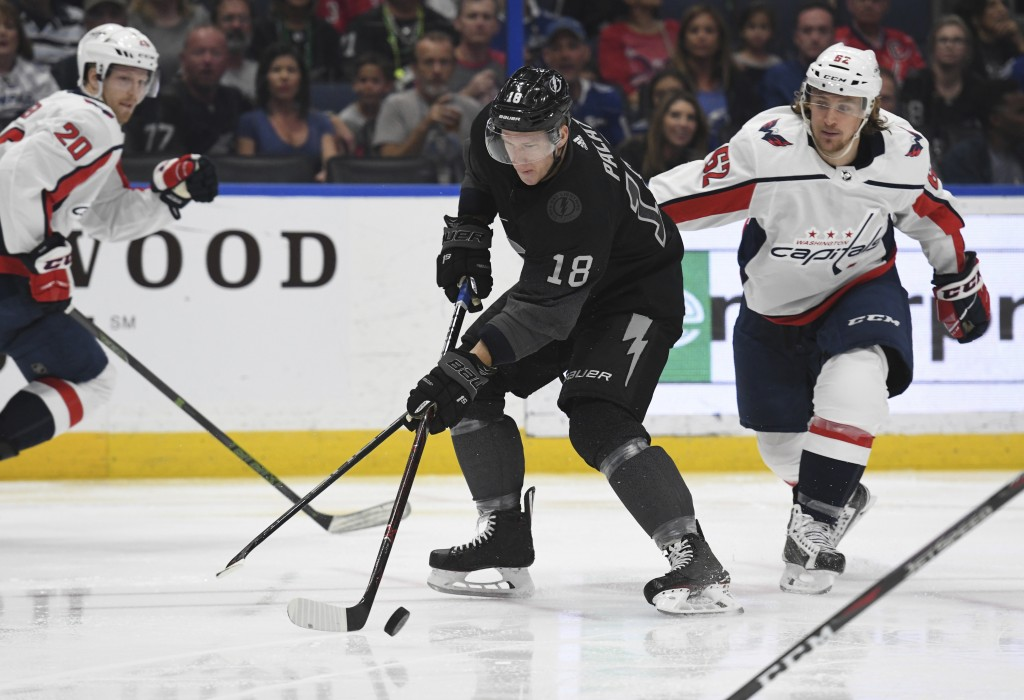 Tampa Bay Lightning left wing Ondrej Palat (18) handles the puck against Washington Capitals left wing Carl Hagelin (62) during the second period of a