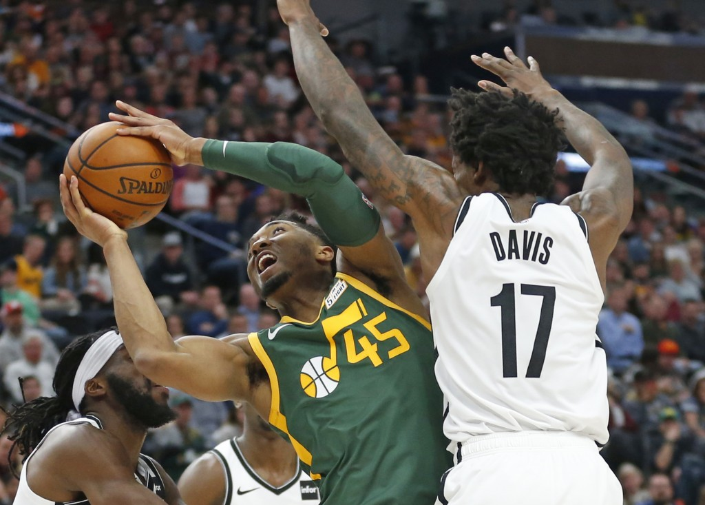 Utah Jazz guard Donovan Mitchell (45) goes to the basket as Brooklyn Nets forward Ed Davis (17) defends during the first half of an NBA basketball gam