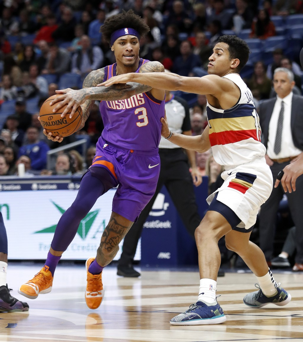 Phoenix Suns forward Kelly Oubre Jr. (3) drives past New Orleans Pelicans guard Frank Jackson (15) during the first half of an NBA basketball game in
