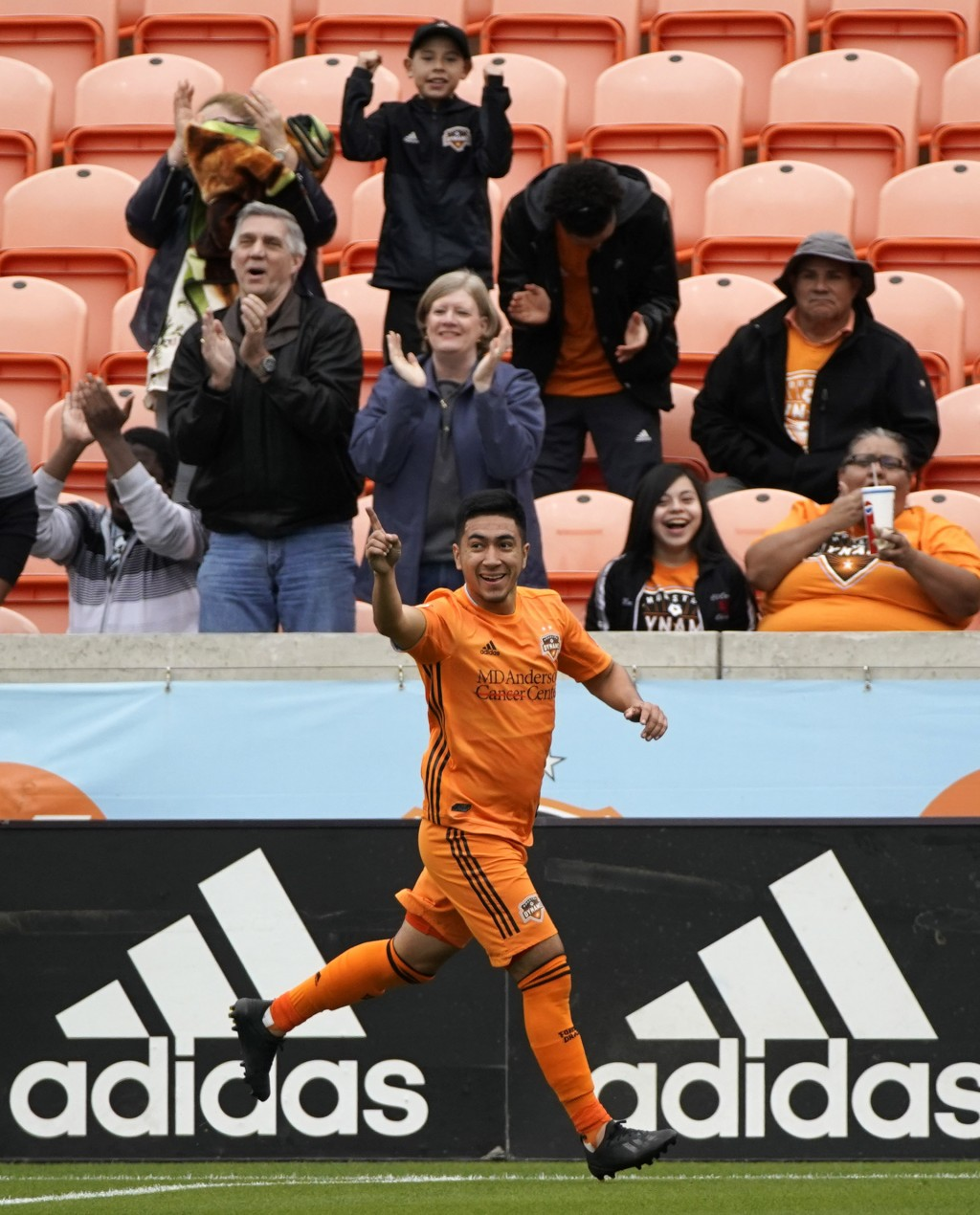 Houston Dynamo's Memo Rodriguez celebrates after scoring a goal against the Vancouver Whitecaps during the first half of an MLS soccer match Saturday,