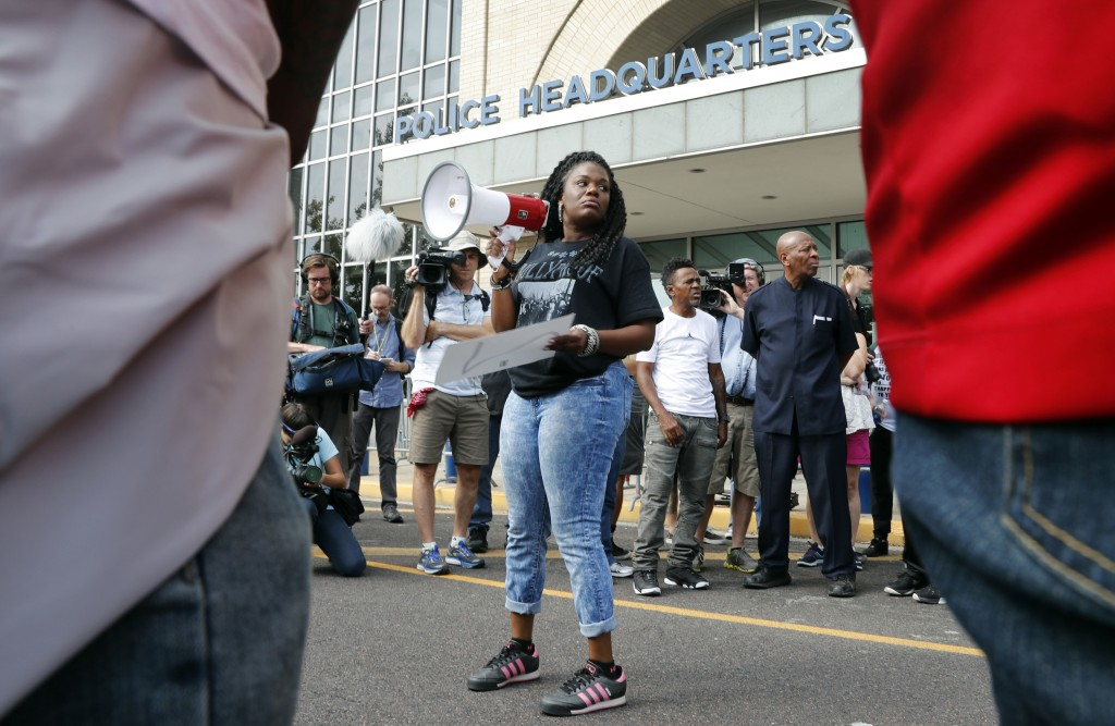 FILE - In this Sept. 17, 2017 file photo, Cori Bush speaks on a bullhorn to protesters outside the St. Louis Police Department headquarters in St. Lou