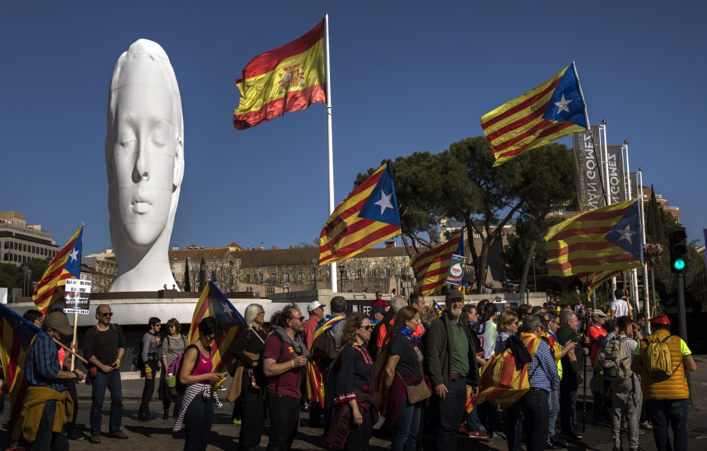 "Catalan pro-independence demonstrators hold ""esteladas,"" or separatist flags, as they arrive to Madrid, Spain, Saturday, March 16, 2019. Tens of thous"
