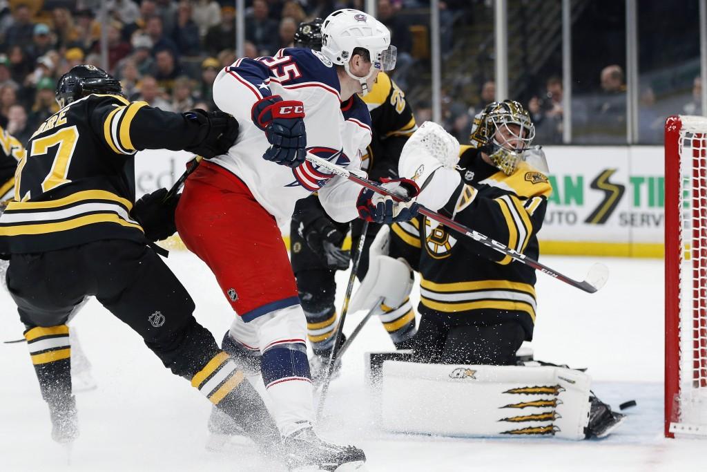 Columbus Blue Jackets' Matt Duchene (95) scores on Boston Bruins' Jaroslav Halak, right, during the first period of an NHL hockey game in Boston, Satu