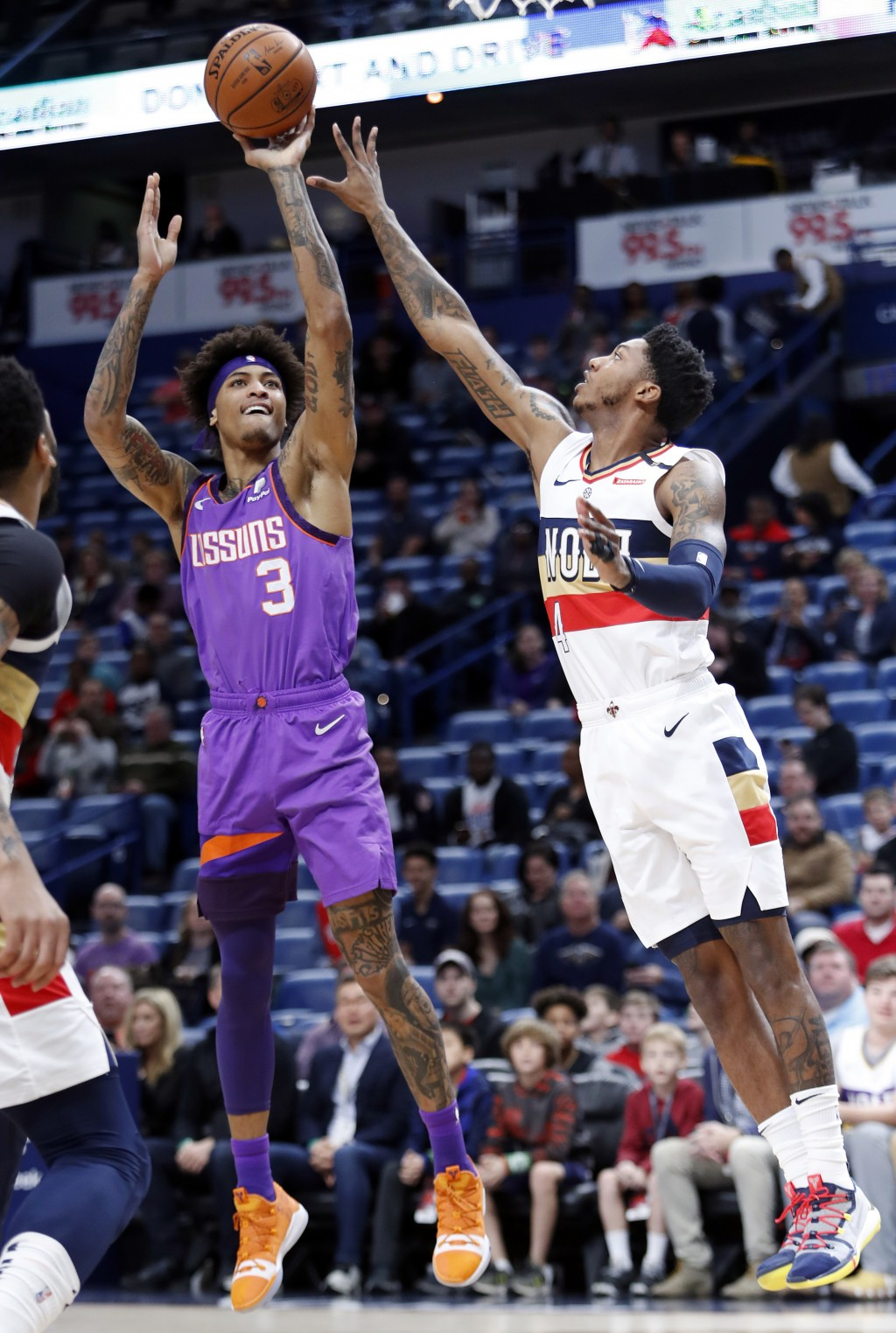 Phoenix Suns forward Kelly Oubre Jr. (3) shoots over New Orleans Pelicans guard Elfrid Payton (4) during the first half of an NBA basketball game in N