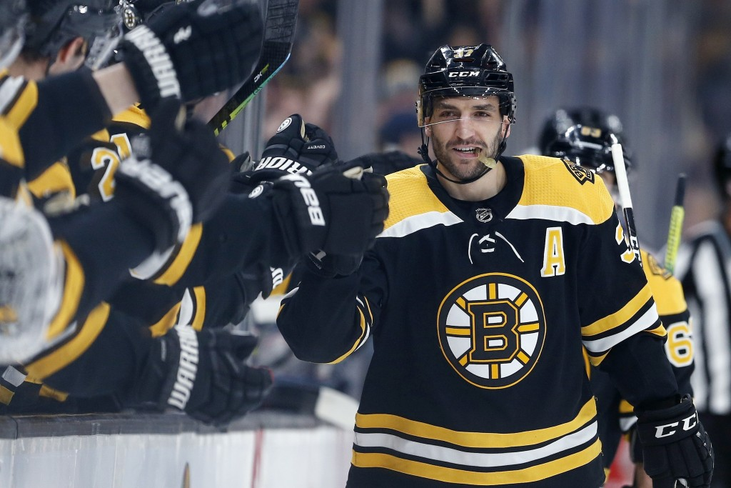 Boston Bruins' Patrice Bergeron celebrates his goal during the first period of the team's NHL hockey game against the Columbus Blue Jackets in Boston,