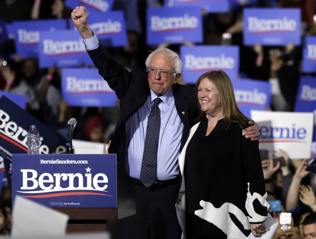FILE - In this March 3, 2019, file photo, Sen. Bernie Sanders, I-Vt., left, and his wife, Jane Sanders, greet supporters as they leave after his 2020